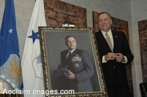 Clipart Photo of Former Air Force Chief of Staff Stands Beside His Own Portrait
