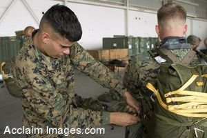 Clipart Photograph of a Soldier Checks Over a Fellow Marine