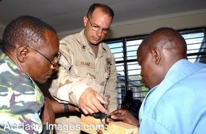 Clipart Photo of Navy Soldier Showing Kenyan Divers an Explosive Device