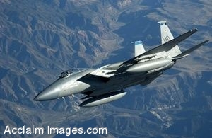 Clip Art Photo of an F-15 Eagle Flying Over Mountains