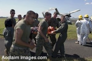 Clipart Photograph of Soldiers Carrying an Injured Pilot Away From Crash