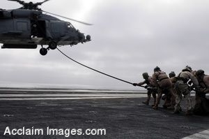 Clip Art Photo of Soldiers on a Flight Deck Pulling a Rope Attached to a Helicopter