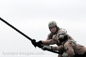 Clip Art Photo of Two Soldiers Climbing a Rope