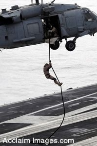 Clip Art Photo of a Soldier Propelling Down a Rope Onto a Flight Deck From a Helicopter