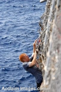 Clip Art Photo of Young Man Climbing a Rope Net up the Side of a Navy Ship