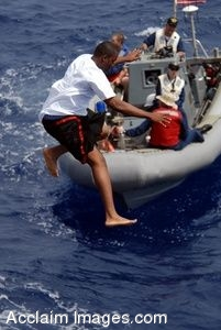 Clipart Photograph of a Boy Leaping Into the Water From a Navy Ship