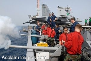 Clipart Photograph of Sailors Firing 40mm Guns Mounted on the Side of a Ship