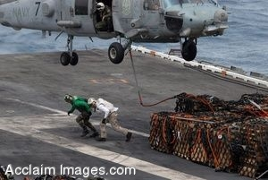 Sailors Helping With Cargo Under a Helicopter in a Clipart Picture