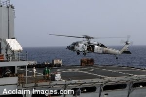 Clip Art Photo of Cargo Being Dropped Onto A Ship Flight Deck By Helipcopter
