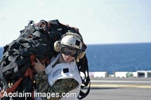 Clipart Photo of a Sailor Carrying a Cargo Net On a Flight Deck