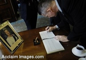 Clipart Photograph of Peter Pace Signing a Guest Book