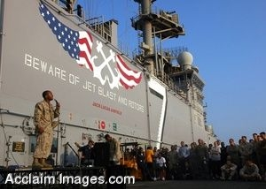 Clipart Photo of a Soldier Standing on Stage By a Ship in With a Crowd of People
