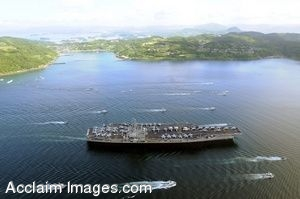 Clipart Photo of an Aircraft Carrier Being Escorted by Boats in a Port