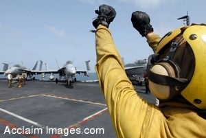 Clip Art Photo of a Flight Crew Member Giving Launch Signals to Aircraft