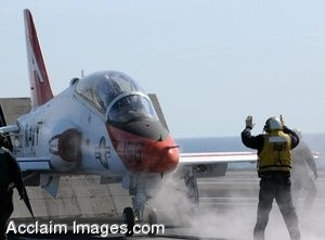 Clipart Photograph of a Jet Stopping in Front of a Sailor on a Flight Deck