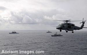 Clipart Photo of a Helicopter Flying Over the Ocean Next To Military Ships