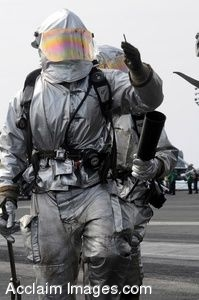 Clipart Picture of Sailors in Safety Suits Walking Across a Flight Deck