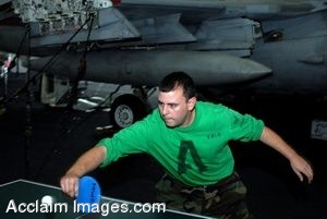 Clipart Photograph of a Sailor Playing a Game of Ping Pong