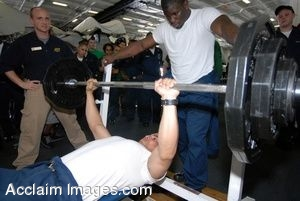 Clipart Photograph of a Sailor Lifting Weights on a Weight Bench