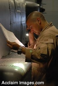 Clipart Photograph of a Soldier Inspecting a Helicopter During Maintenance