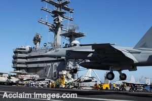 Clipart photograph of an Aircraft Carrier With A Jet Landing On It