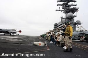 Clipart Photo of Soldiers Gathered on an Aircraft Carrier Flight Deck As Jets Land