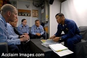 Clipart Photo of An Officer Sitting At a Table Instructing Soldiers