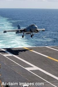 Clipart Photograph of A Military Jet Coming In To Land on an Aircraft Carrier