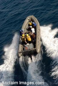Clip Art Photo of an Inflatable Boat Traveling Through the Ocean Carrying Soldiers