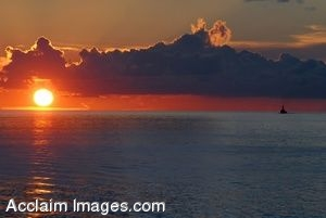 Clipart Photograph of An Aircraft Carrier in the Pacific Ocean at Sunset