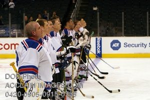 Stock Picture of Military Hockey Team on Ice Rink During National Anthem