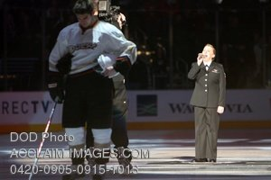 A Soldier Singing the National Anthem on an Ice Rink in a Stock Picture