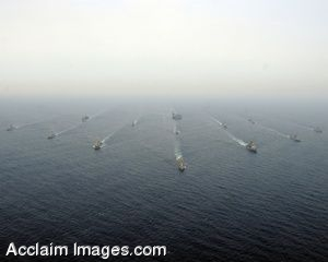 Clipart Photo of A Group of Military Ships Sailing Through the Ocean