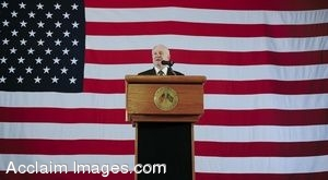 Clip Art Photo of Robert M. Gates Giving a Speech in Front of a Huge American Flag
