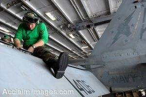 Clipart Picture of a Military Mechanic Working on a Jet