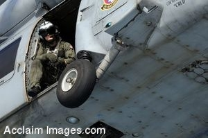 Clipart Photo of A Soldier Sitting inside of a Helicopter During Flight