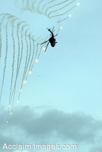 Clipart Picture of a Military Helicopter Flying And Shooting Flares