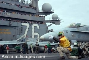 Clipart Photo of a Jet Being Signaled To Launch By A Soldier