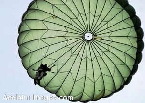 Clipart Photo of a Military Paratrooper Coming In To Land