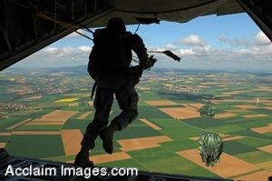 Clipart Photo of a Jet With A Paratrooper Jumping Out