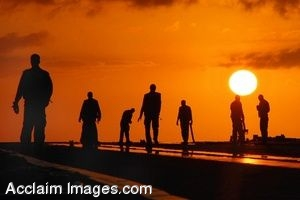 Clipart Photo of The Silhouettes of Sailors Against the Setting Sun