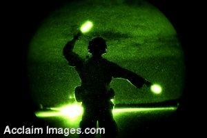 Clipart Photo of a Soldier Guiding A Plane Using Flares
