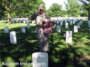 Clipart Photo of a Grave At Arlington Cemetery With a Soldier Saluting It