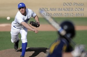 Stock Photo Clip Art Image of a Baseball Player Pitching a Ball to a Batter Off The Mound
