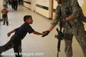 Clipart Photo of a Soldier Getting A High Five From an Iraqi Child