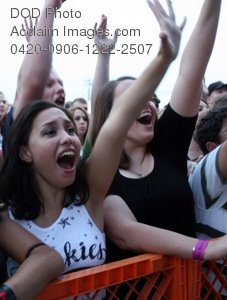 Clip Art Stock Photo of Fans Screaming at the Gate to a Concert