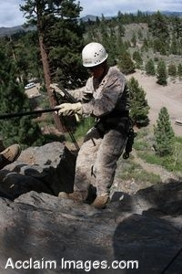 Clipart Photo of a Soldier Climbing Up a Rocky Cliff