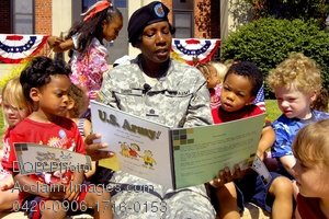 Clip Art Stock Photo of a Female Soldier Reading to Children