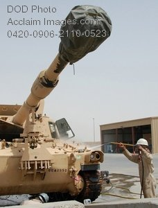 Clip Art Stock Photo of a Soldier Cleaning a Howitzer Tank