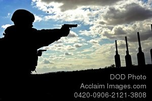 Clip Art Stock Photo of a Soldier Shooting Targets at Sunset